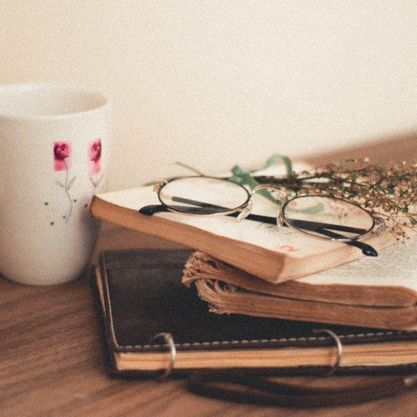white-ceramic-mug-on-brown-wooden-table-